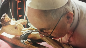 "Pope Francis having a ""special time"" kissing an idol."