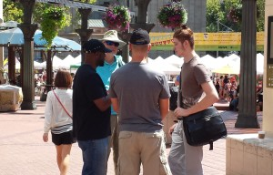 Robert Gray and two Biblical Church Evangelism Conference attenders delivering the Gospel to a man in downtown Portland.