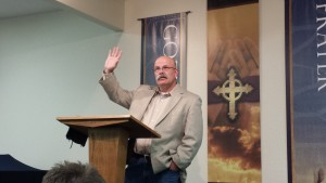 Tony Miano preaching during an evening instruction session of the Biblical Church Evangelism Conference.