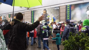 Mason Goodnight lifting his hands high to proclaim Jesus at the Seahawks pre-season game with the Broncos.